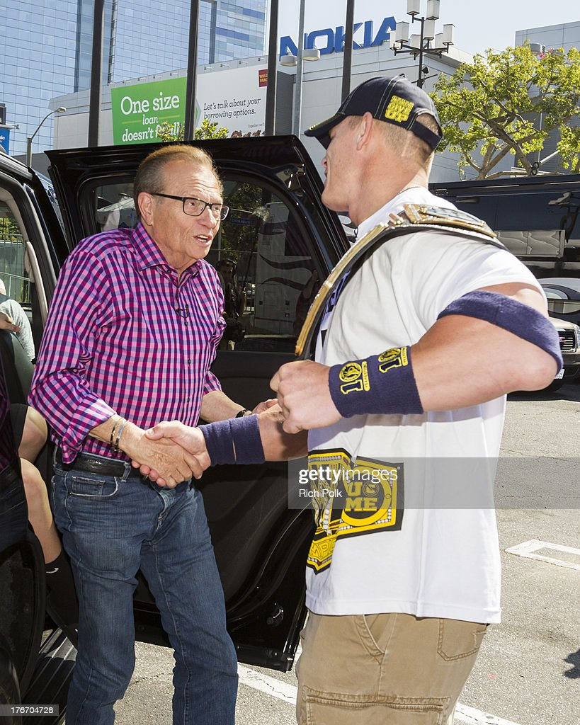 <a gi-track='captionPersonalityLinkClicked' href=/galleries/search?phrase=John+Cena&family=editorial&specificpeople=644116 ng-click='$event.stopPropagation()'>John Cena</a> greets Larry King at WWE Superstar <a gi-track='captionPersonalityLinkClicked' href=/galleries/search?phrase=John+Cena&family=editorial&specificpeople=644116 ng-click='$event.stopPropagation()'>John Cena</a> runs into Scooby backstage at Summerslam's Fan Axxess. The two will reunite this spring in WWE Studios & Warner Bros. Scooby-Doo! WrestleMania Mystery at Summer Slam 2013.' on August 17, 2013 in Los Angeles, California.