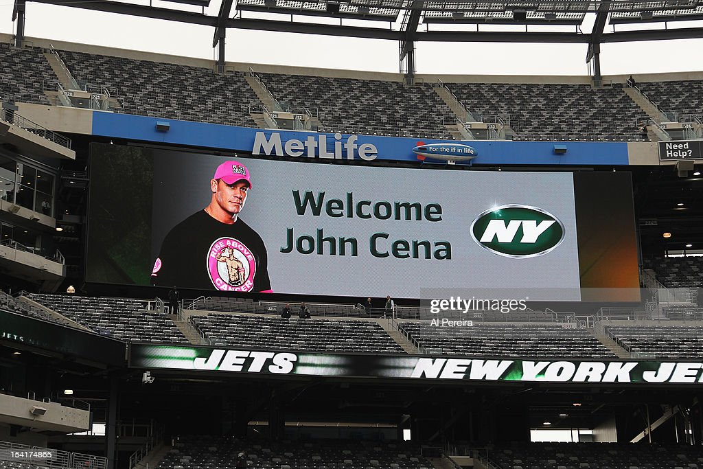 <a gi-track='captionPersonalityLinkClicked' href=/galleries/search?phrase=John+Cena&family=editorial&specificpeople=644116 ng-click='$event.stopPropagation()'>John Cena</a> is welcomed on the scoreboard when he attends the football game between the Jets and the Colts at the MetLife Stadium on October 14, 2012 in East Rutherford, New Jersey.