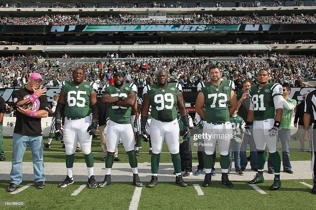 <a gi-track='captionPersonalityLinkClicked' href=/galleries/search?phrase=John+Cena&family=editorial&specificpeople=644116 ng-click='$event.stopPropagation()'>John Cena</a> (L) joins the New York Jets Team Captains (2nd L-R) <a gi-track='captionPersonalityLinkClicked' href=/galleries/search?phrase=Brandon+Moore&family=editorial&specificpeople=241545 ng-click='$event.stopPropagation()'>Brandon Moore</a>, Demario Davis, Daniel Muir, Caleb Schlauderaff, <a gi-track='captionPersonalityLinkClicked' href=/galleries/search?phrase=Dustin+Keller&family=editorial&specificpeople=2160327 ng-click='$event.stopPropagation()'>Dustin Keller</a>, when he attends the football game between the Jets and the Colts at the MetLife Stadium on October 14, 2012 in East Rutherford, New Jersey.