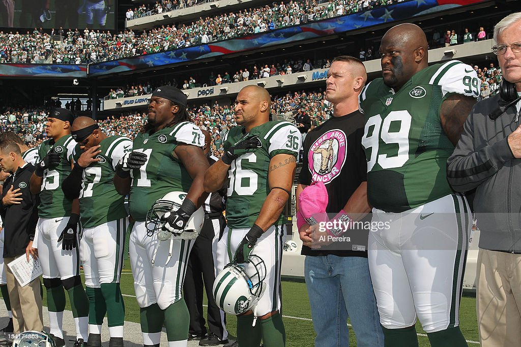 <a gi-track='captionPersonalityLinkClicked' href=/galleries/search?phrase=John+Cena&family=editorial&specificpeople=644116 ng-click='$event.stopPropagation()'>John Cena</a> lines up with the New York Jets for the National Anthem when he attends the football game between the Jets and the Colts at the MetLife Stadium on October 14, 2012 in East Rutherford, New Jersey.