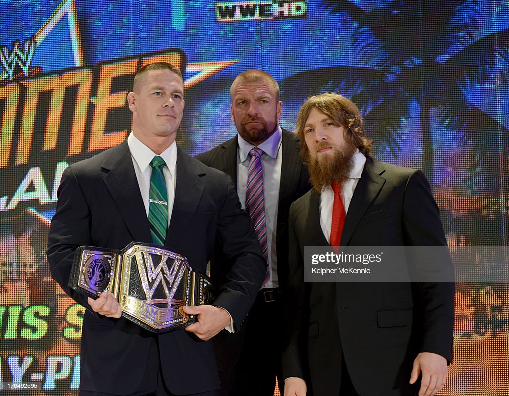 John Cena, Paul 'Triple H' Levesque and Daniel Bryan pose at the WWE SummerSlam Press Conference at Beverly Hills Hotel on August 13, 2013 in Beverly Hills, California.