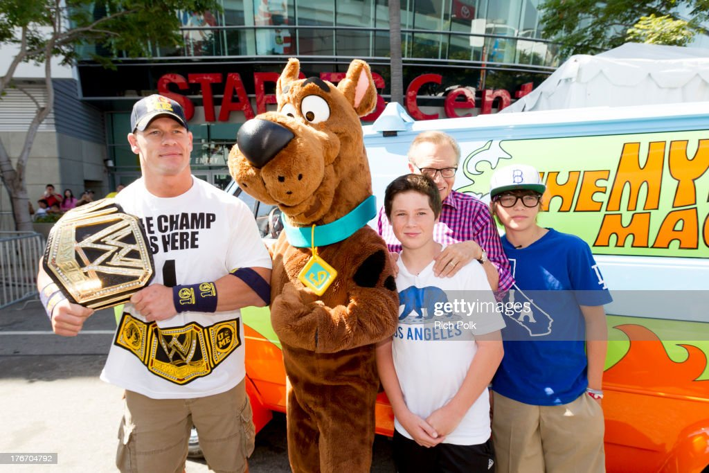 <a gi-track='captionPersonalityLinkClicked' href=/galleries/search?phrase=John+Cena&family=editorial&specificpeople=644116 ng-click='$event.stopPropagation()'>John Cena</a>, Scooby-Doo, <a gi-track='captionPersonalityLinkClicked' href=/galleries/search?phrase=Larry+King&family=editorial&specificpeople=202014 ng-click='$event.stopPropagation()'>Larry King</a> and his sons pose for a photo at WWE Superstar <a gi-track='captionPersonalityLinkClicked' href=/galleries/search?phrase=John+Cena&family=editorial&specificpeople=644116 ng-click='$event.stopPropagation()'>John Cena</a> runs into Scooby backstage at Summerslam's Fan Axxess. The two will reunite this spring in WWE Studios & Warner Bros. Scooby-Doo! WrestleMania Mystery at Summer Slam 2013.' on August 17, 2013 in Los Angeles, California.