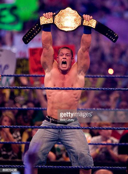 John Cena shows off his new World Heavyweight Championship belt after defeating The Big Show and Edge in triple threat match at 'WrestleMania 25' at...