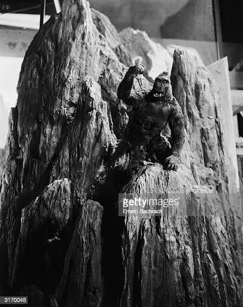 John Cerisoli's model of the giant ape climbs a mountain carrying a miniature Fay Wray doll in a scene from the classic monster movie 'King Kong'