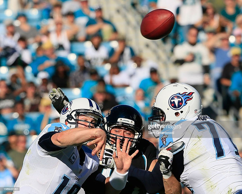 John Chick #97 of the Jacksonville Jaguars pressures Jake Locker #10 of the Tennessee Titans during the game at EverBank Field on November 25, 2012 in Jacksonville, Florida.
