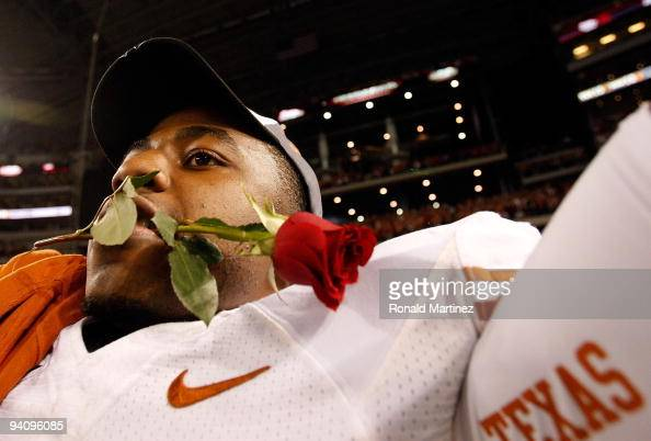John Chiles of the Texas Longhorns with a rose in his mouth after a win against the Nebraska Cornshuskers at Cowboys Stadium on December 5 2009 in...