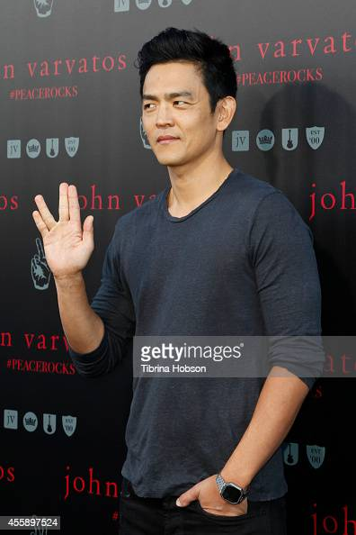 John Cho attends John Varvatos International Day of Peace with Ringo Starr at John Varvatos Boutique on September 21 2014 in West Hollywood California