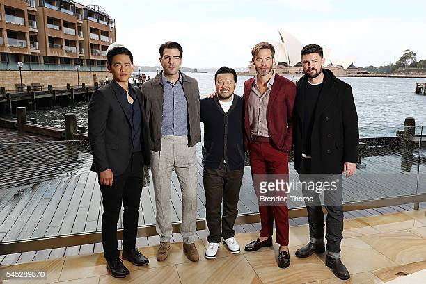 John Cho Zachary Quinto Director Justin Lin Chris Pine and Karl Urban pose during a photo call for Star Trek Beyond on July 7 2016 in Sydney Australia
