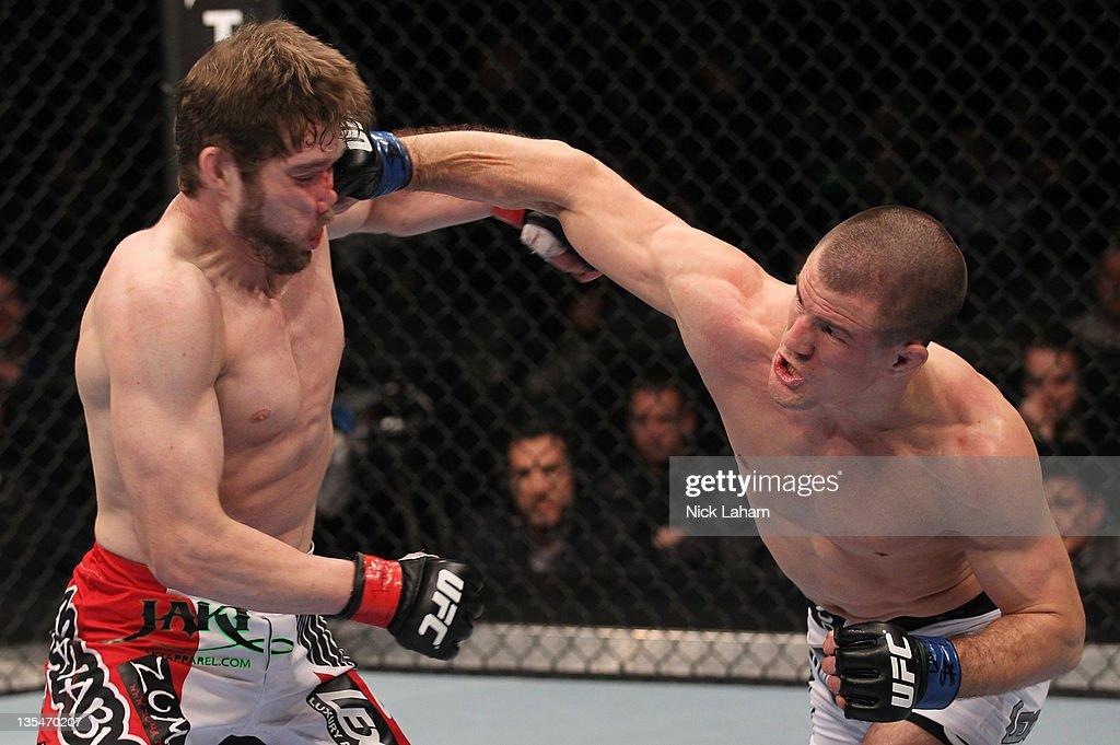 John Cholish punches Mitch Clarke during the UFC 140 event at Air Canada Centre on December 10, 2011 in Toronto, Canada.