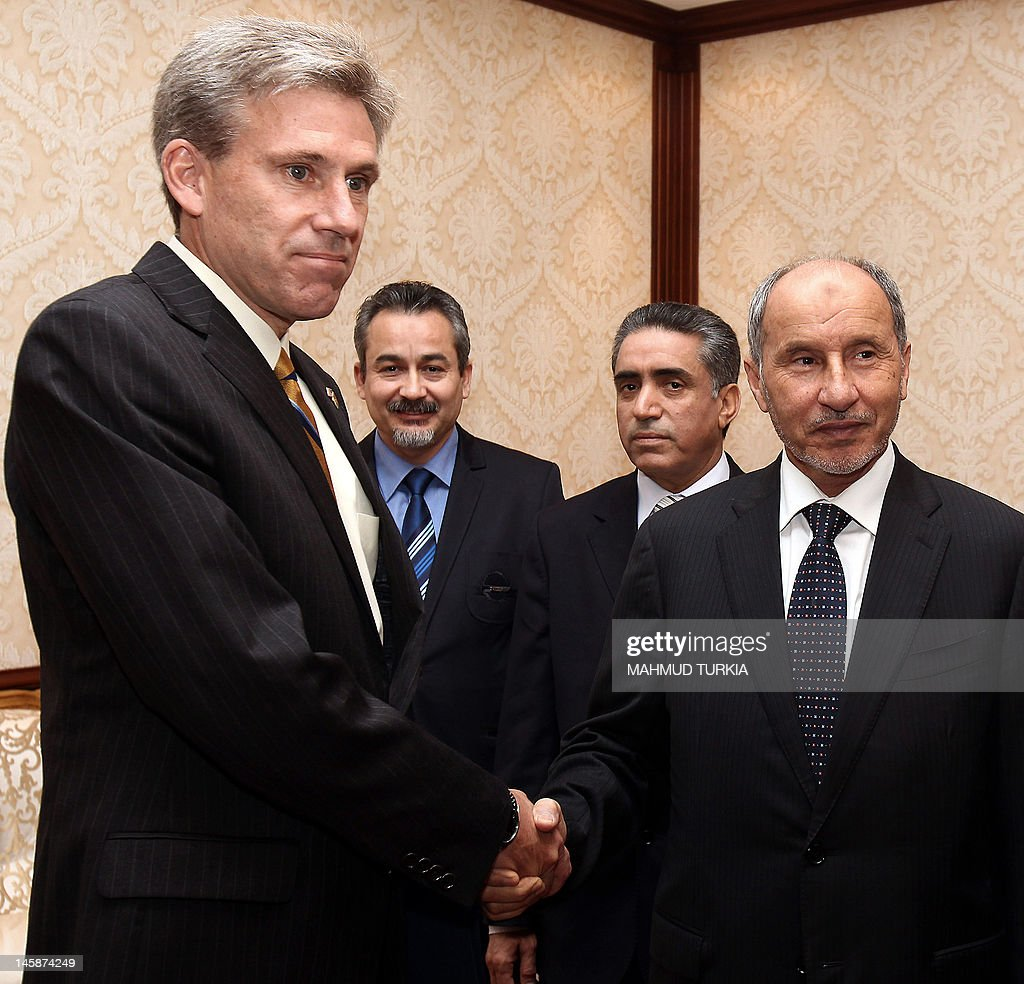 John Christopher Stevens newly appointed US ambassador to Libya shakes hands with Libyan National Transitional Council chairman Mustafa Abdel Jalil...