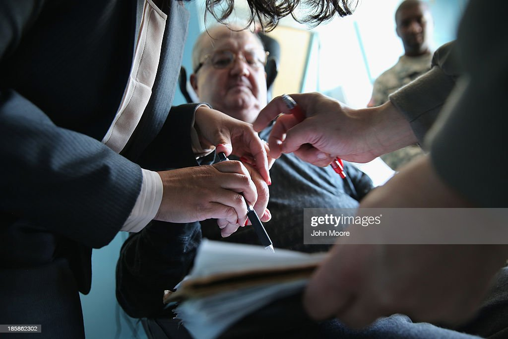 John Cincar, 62, receives help to sign the oath of allegiance to the United States at a ''homebound'' naturalization ceremony on October 25, 2013 in the Queens borough of New York City. Cincar, who was born in Yugoslavia and moved to the United States in 1965, has been a quadripelegic since falling at home in 2011 and now lives in the Midway Nursing Home. U.S. Citizenship and Immigration Services (USCIS), performs such on site naturalization ceremonies for immigrants with health issues and disabilities who have limited mobility. With his new American citizenship, Cincar says he plans to apply for a U.S. passport and, after further physical rehabilitation, hopes to travel back to his village near Belgrade, Serbia to visit family members he has not seen since his youth. He served in the U.S. Army from 1969-1972 as a supply clerk in Germany.