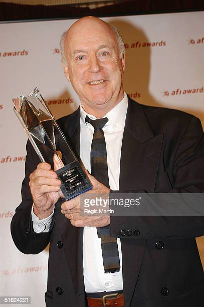John Clarke holds his Byron Kennedy Award at the AFI Awards at the Regent Theatre October 29 2004 in Melbourne Australia