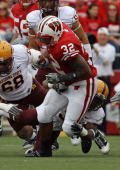 John Clay of the Wisconsin Badgers runs against the Arizona State Sun Devils at Camp Randall Stadium on September 18 2010 in Madison Wisconsin...