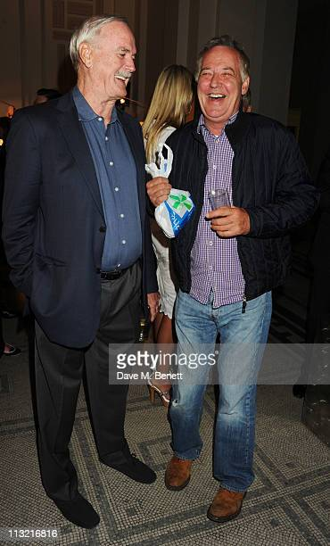 John Cleese and Michael Barrymore attend the private view of Jonathan Wylder's new exhibition at the Victoria Albert Museum on April 27 2011 in...