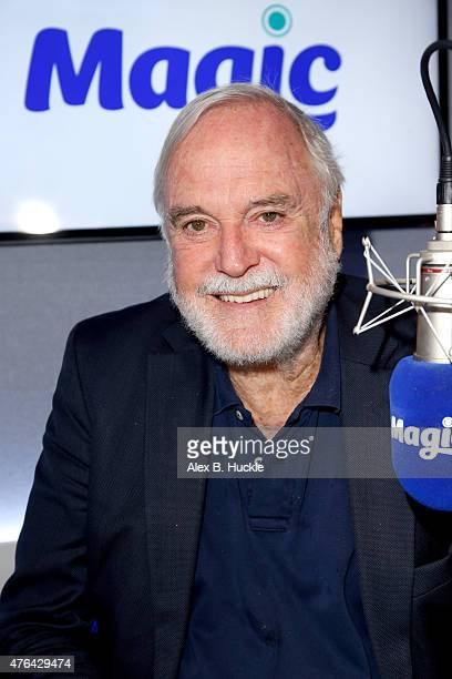 John Cleese poses for pictures during a visit to Magic Radio on June 9 2015 in London England