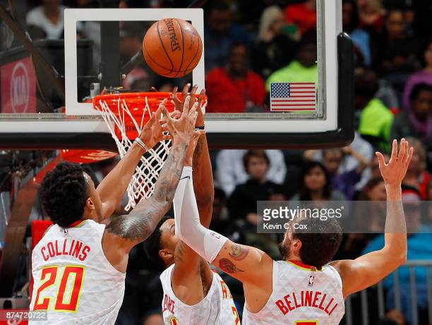 John Collins Kent Bazemore and Marco Belinelli of the Atlanta Hawks battle for a rebound against the Sacramento Kings at Philips Arena on November 15...
