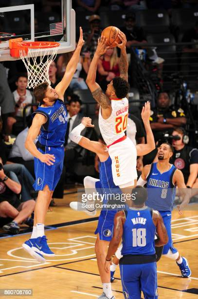 John Collins of the Atlanta Hawks goes to the basket against the Dallas Mavericks on October 12 2017 at McCamish Pavilion in Atlanta Georgia NOTE TO...