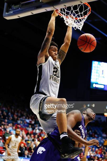 John Collins of the Wake Forest Demon Deacons dunks the ball against DJ Johnson of the Kansas State Wildcats in the second half during the First Four...