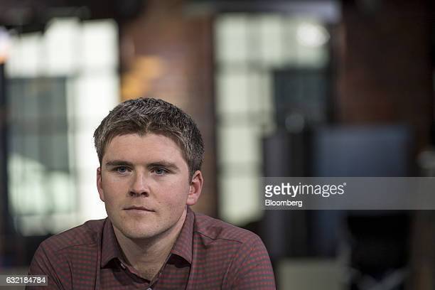 John Collison president and cofounder of Stripe Inc listens during a Bloomberg Technology television interview in San Francisco California US on...