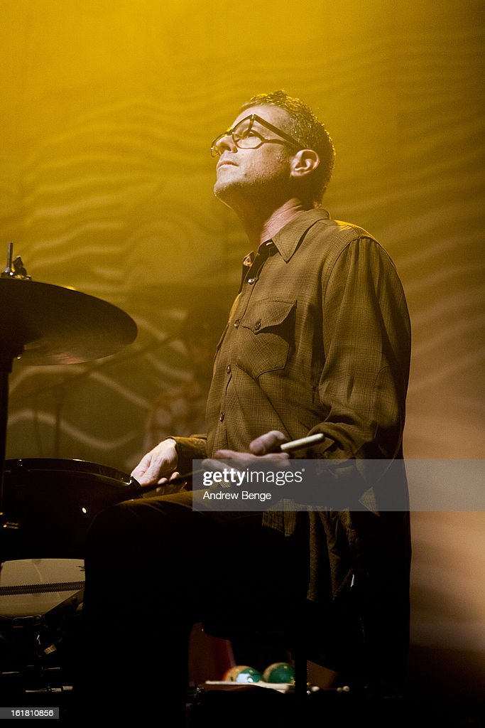 John Convertino of Calexico perform on stage at HMV Ritz on February 16, 2013 in Manchester, England.