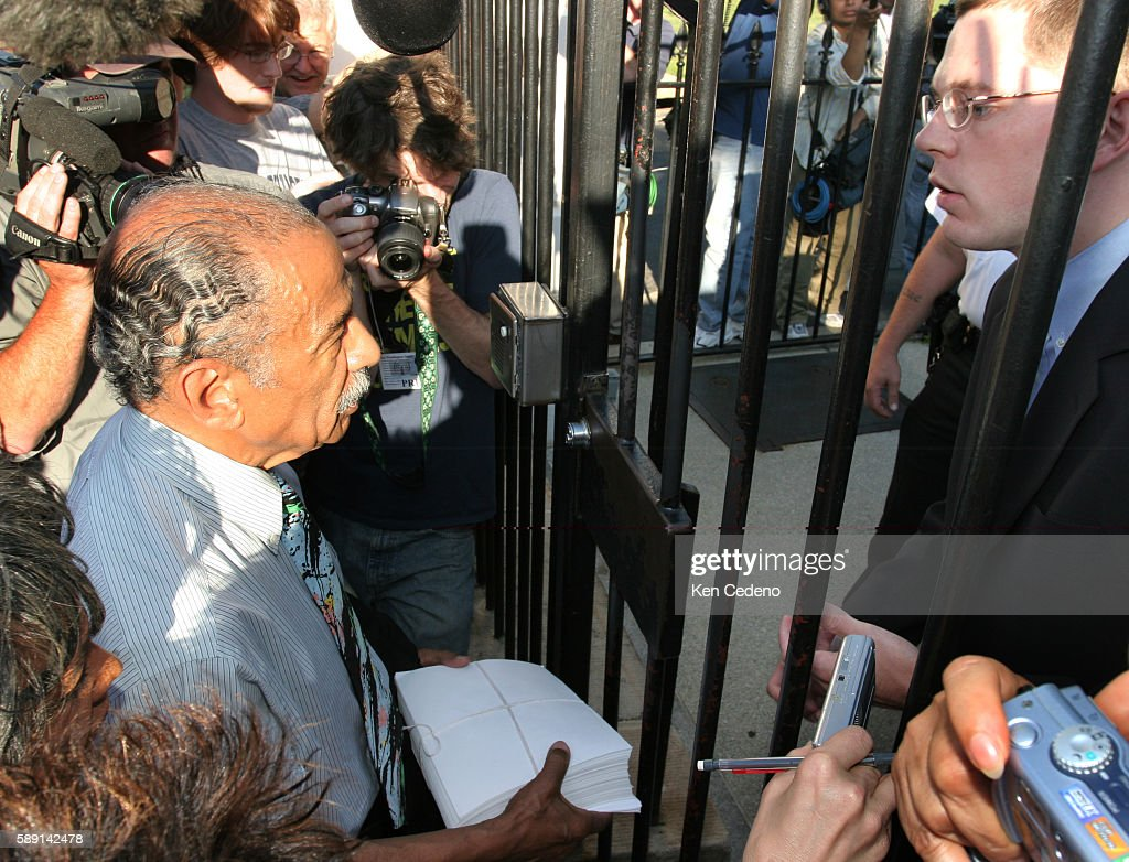 John Conyers DMich left ranking Democrat on the House Judiciary Committee delivers 540000 petitions to White House staffers for President Bush at the...