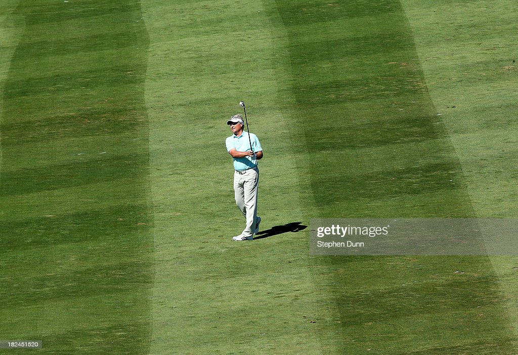 <a gi-track='captionPersonalityLinkClicked' href=/galleries/search?phrase=John+Cook&family=editorial&specificpeople=564375 ng-click='$event.stopPropagation()'>John Cook</a> hits his second shot on the sixth hole durng the final round of the Nature Valley First Tee Open at Pebble Beach at Pebble Beach Golf Links on September 29, 2013 in Pebble Beach, California.