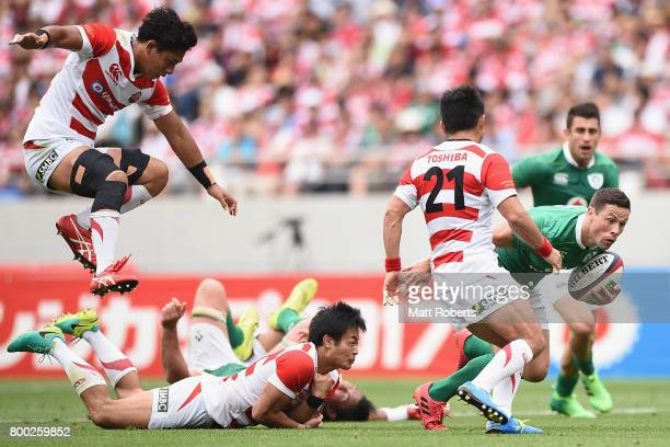 John Cooney of Ireland makes a break during the international rugby friendly match between Japan and Ireland at Ajinomoto Stadium on June 24 2017 in...