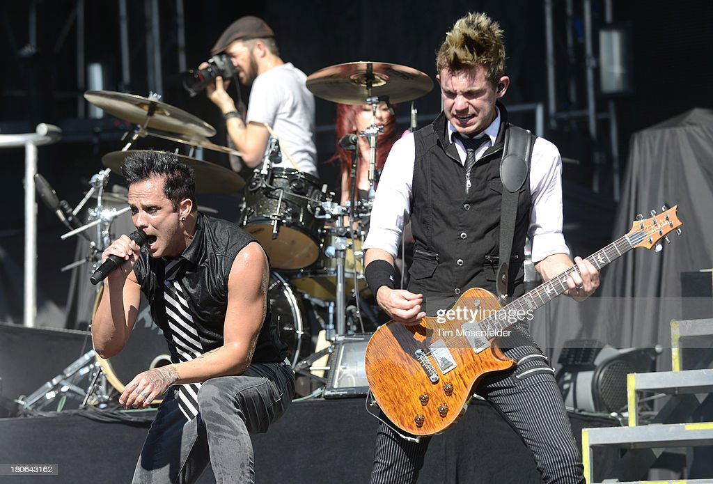 John Cooper (L) and Seth Morrison of Skillet perform as part of the Aftershock Music Festival at Discovery Park on September 14, 2013 in Sacramento, California.