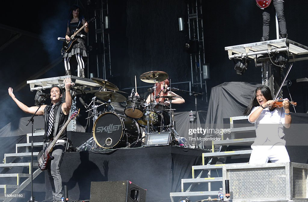 John Cooper (L) of Skillet performs as part of the Aftershock Music Festival at Discovery Park on September 14, 2013 in Sacramento, California.