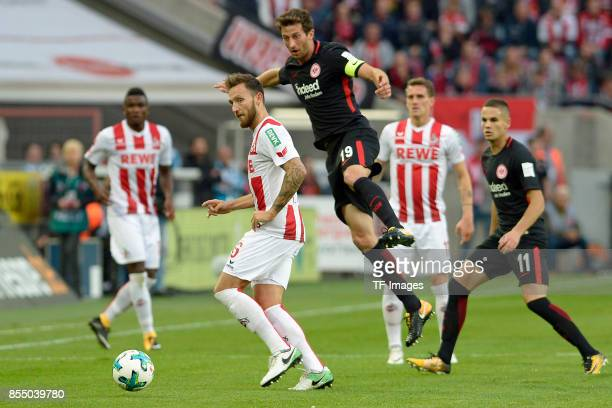 John Cordoba of Koeln and Marco Höger of Koeln and David Abraham of Frankfurt and Simon Zoller of Koeln and Mijat Gacinovic of Frankfurt battle for...
