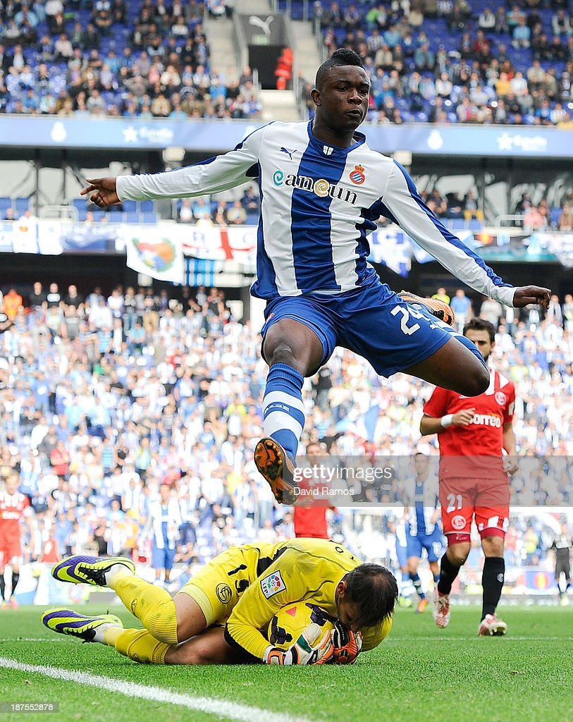 John Cordoba of RCD Espanyol jumps over <a gi-track='captionPersonalityLinkClicked' href=/galleries/search?phrase=Beto+-+Portuguese+Soccer+Goalie&family=editorial&specificpeople=5747462 ng-click='$event.stopPropagation()'>Beto</a> of Sevilla FC during the La Liga match between RCD Espanyol and Sevilla FC at Cornella-El Prat Stadium on November 10, 2013 in Barcelona, Spain.