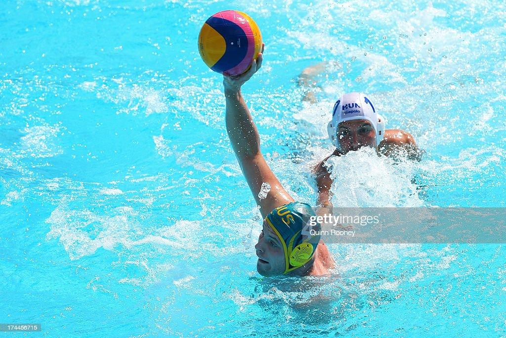 John Cotterill of Australia in action against Denes Varga of Hungary during the Men's Water Polo first preliminary round match between Hungary and...