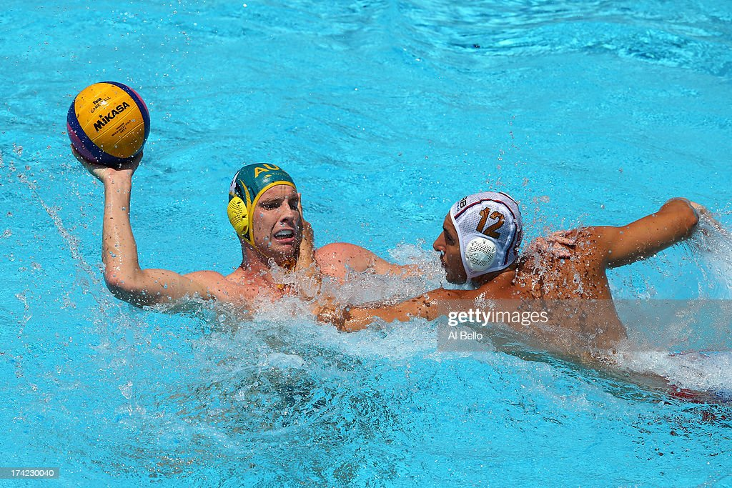 John Cotterill of Australia looks to pass the ball under pressure from Stefan Mitrovic of Serbia during the Men's Water Polo first preliminary round match between Australia and Serbia during day three of the 15th FINA World Championships at Piscines Bernat Picornell on July 22, 2013 in Barcelona, Spain.