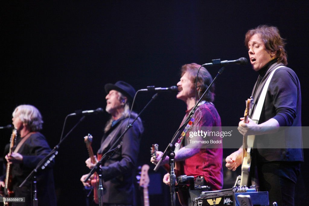 John Cowan, Patrick Simmons, Tom Johnston and John McFee of The Doobie Brothers perform at the 95.5 KLOS Christmas Show held at Nokia Theatre L.A. Live on December 13, 2012 in Los Angeles, California.