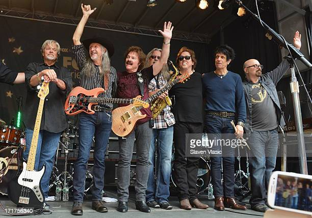 John Cowan Patrick Simmons Tom Johnston Marc Russo John McFee and Tony Pia of the Doobie Brothers perform during 'FOX Friends' All American Concert...