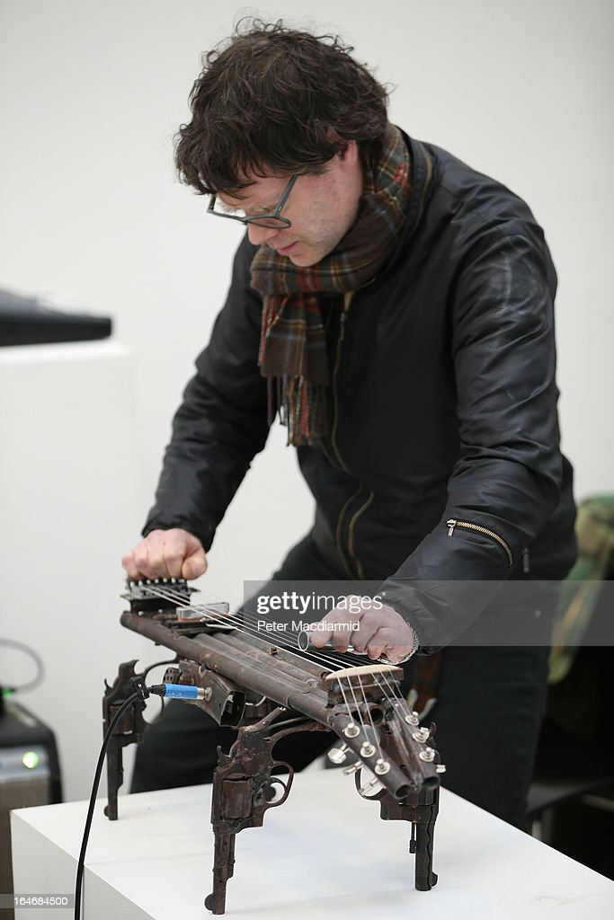 John Coxon plays a musical instrument made from recycled gun parts at the Lisson Gallery on March 26, 2013 in London, England. Mexican artist Pedro Reyes received 6,700 destroyed weapons from the Mexican government from which he sculpted two groups of instruments. The first, a series titled Imagine, is an orchestra of fifty instruments, from flutes to string and percussion instruments, designed to be played live. The second, Disarm, is an installation of mechanical musical instruments, which can either be automated or played live by an individual operator using a laptop computer or midi keyboard.