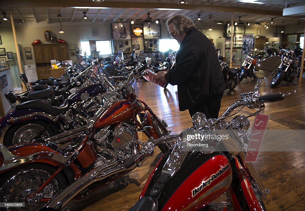 John Craig looks at a Harley-Davidson Inc. motorcycle on the showroom floor at the Dudley Perkins Co. dealership in South San Francisco, California, U.S., on Monday, Jan. 28, 2013. Harley-Davidson reported fourth quarter revenue of $1.17 billion. Photographer: David Paul Morris/Bloomberg via Getty Images