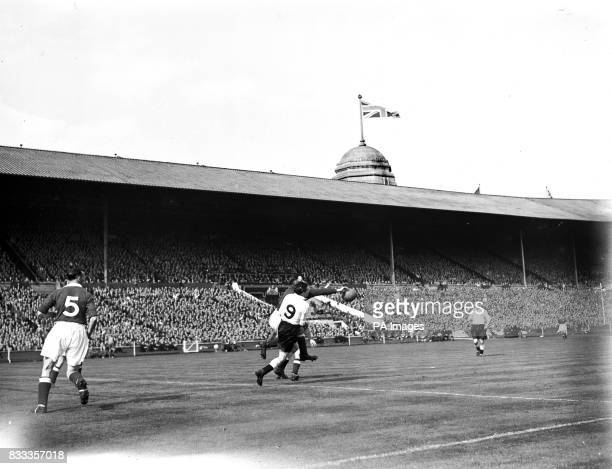 John Crompton Manchester United Goalkeeper dives out to save from Stanley Mortensen Blackpool's centre forward during a Blackpool attack at the Cup...