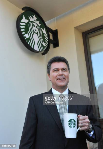 John Culver president of Starbucks introduces the 'VIA' branded singleserving coffee packets at a Starbucks outlet in Beijing on March 8 2011 US...