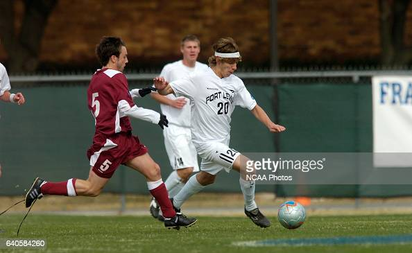 John Cunliffe of Fort Lewis and Brendan McMahon of Franklin Pierce battle for the ball during the Men's Division II Soccer Championship held on the...