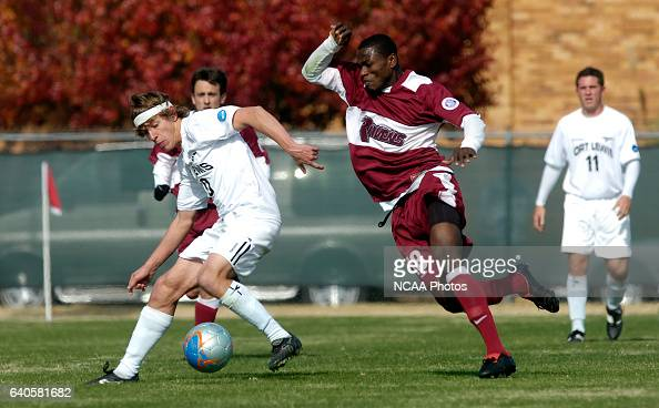 John Cunliffe of Fort Lewis and Michael AduGvamfi of Franklin Pierce battle for the ball during the Men's Division II Soccer Championship held on the...