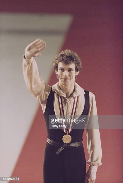 John Curry of Great Britain celebrates his Gold medal after winning the Men's Figure Skating event during the XII Olympic Winter Games on 11 February...