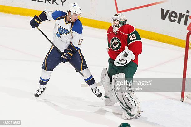 John Curry of the Minnesota Wild makes a save with Vladimir Sobotka of the St Louis Blues awaiting the rebound during the game on April 10 2014 at...