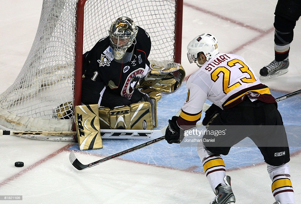 John Curry of the WilkesBarre/Scranton Penguins makes a save on a shot by Colin Stuart of the Chicago Wolves during the Calder Cup Finals on June 10...