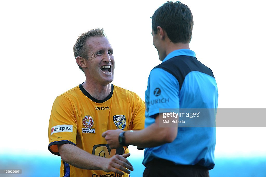 <a gi-track='captionPersonalityLinkClicked' href=/galleries/search?phrase=John+Curtis&family=editorial&specificpeople=550280 ng-click='$event.stopPropagation()'>John Curtis</a> of Gold Coast has a laugh with referee Nathan Macdonald during the round ten A-League match between Gold Coast United and Adelaide United at Skilled Park on October 17, 2010 in Gold Coast, Australia.