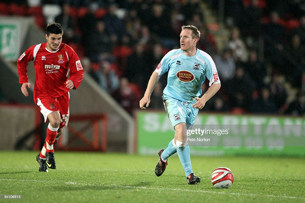 <a gi-track='captionPersonalityLinkClicked' href=/galleries/search?phrase=John+Curtis&family=editorial&specificpeople=550280 ng-click='$event.stopPropagation()'>John Curtis</a> of Northampton Town looks to play the ball during the Coca Cola League Two Match between Cheltenham Town and Northampton Town at The Abbey Business Stadium on December 5, 2009 in Northampton, England.