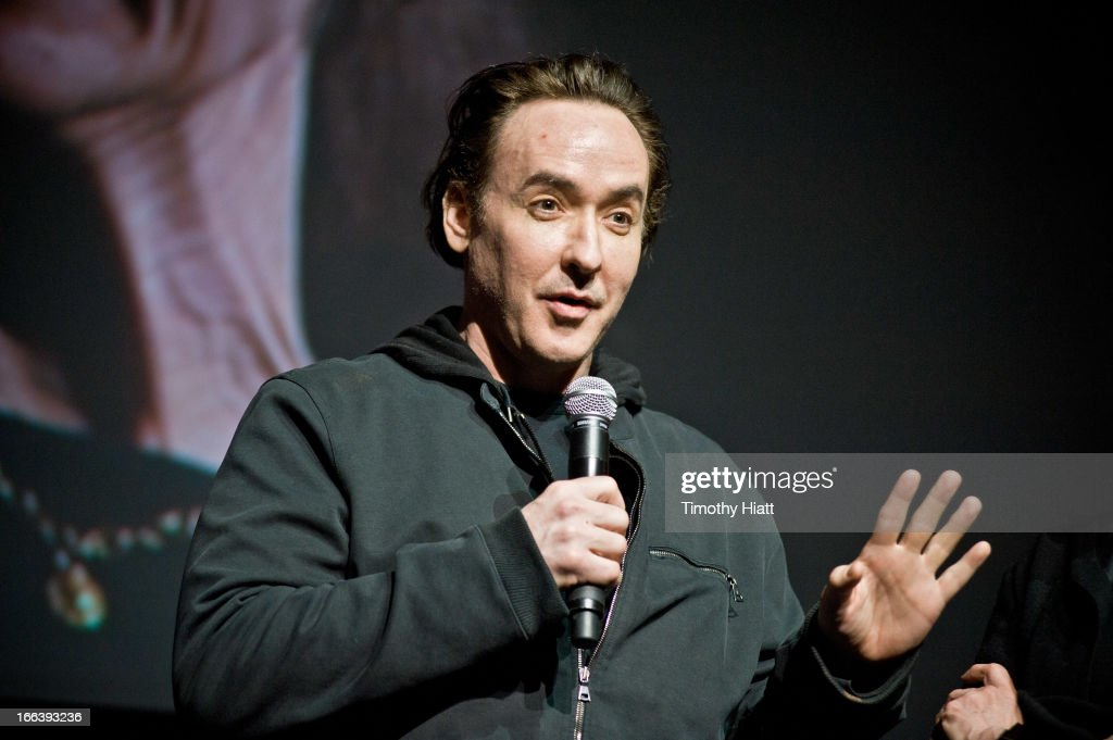 <a gi-track='captionPersonalityLinkClicked' href=/galleries/search?phrase=John+Cusack&family=editorial&specificpeople=216451 ng-click='$event.stopPropagation()'>John Cusack</a> attends the Roger Ebert Memorial Tribute at Chicago Theatre on April 11, 2013 in Chicago, Illinois.