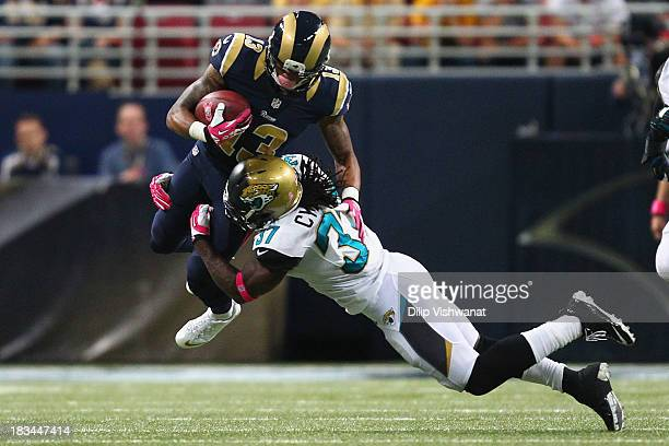 John Cyprien of the Jacksonville Jaguars tackles Chris Givens of the St Louis Rams at the Edward Jones Dome on October 6 2013 in St Louis Missouri