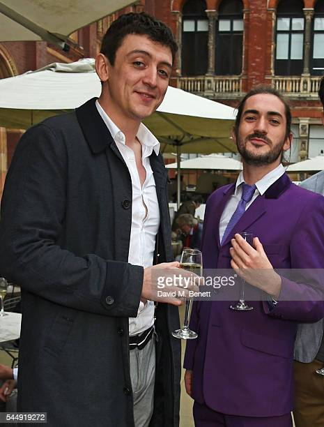 John Dagleish and George Maguire attend the Olivier Awards Summer Party in celebration of the new exhibition 'Curtain Up' at The VA on July 4 2016 in...