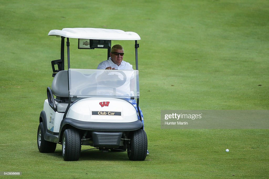 <a gi-track='captionPersonalityLinkClicked' href=/galleries/search?phrase=John+Daly+-+Golfer&family=editorial&specificpeople=4350901 ng-click='$event.stopPropagation()'>John Daly</a> drives a cart to his ball on the 18th hole during the first round of the Champions Tour American Family Insurance Championship at University Ridge Golf Course on June 24, 2016 in Madison, Wisconsin.